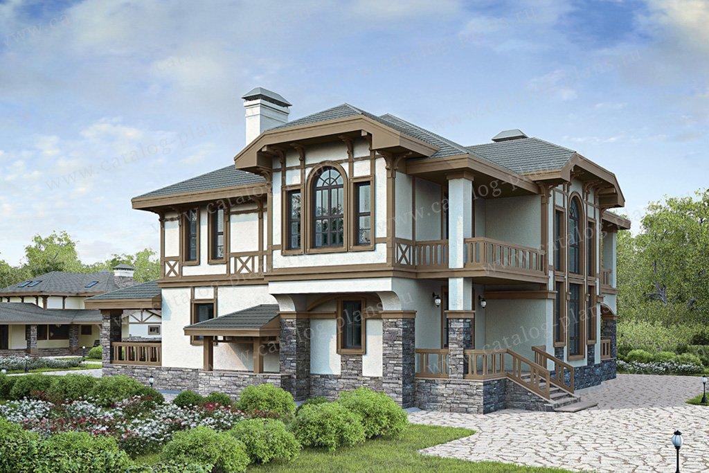 Кирпичный двухэтажный дом с балконом..